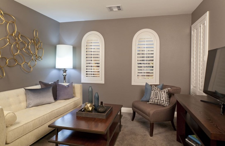 Fort Myers family room with rounded plantation shutters.