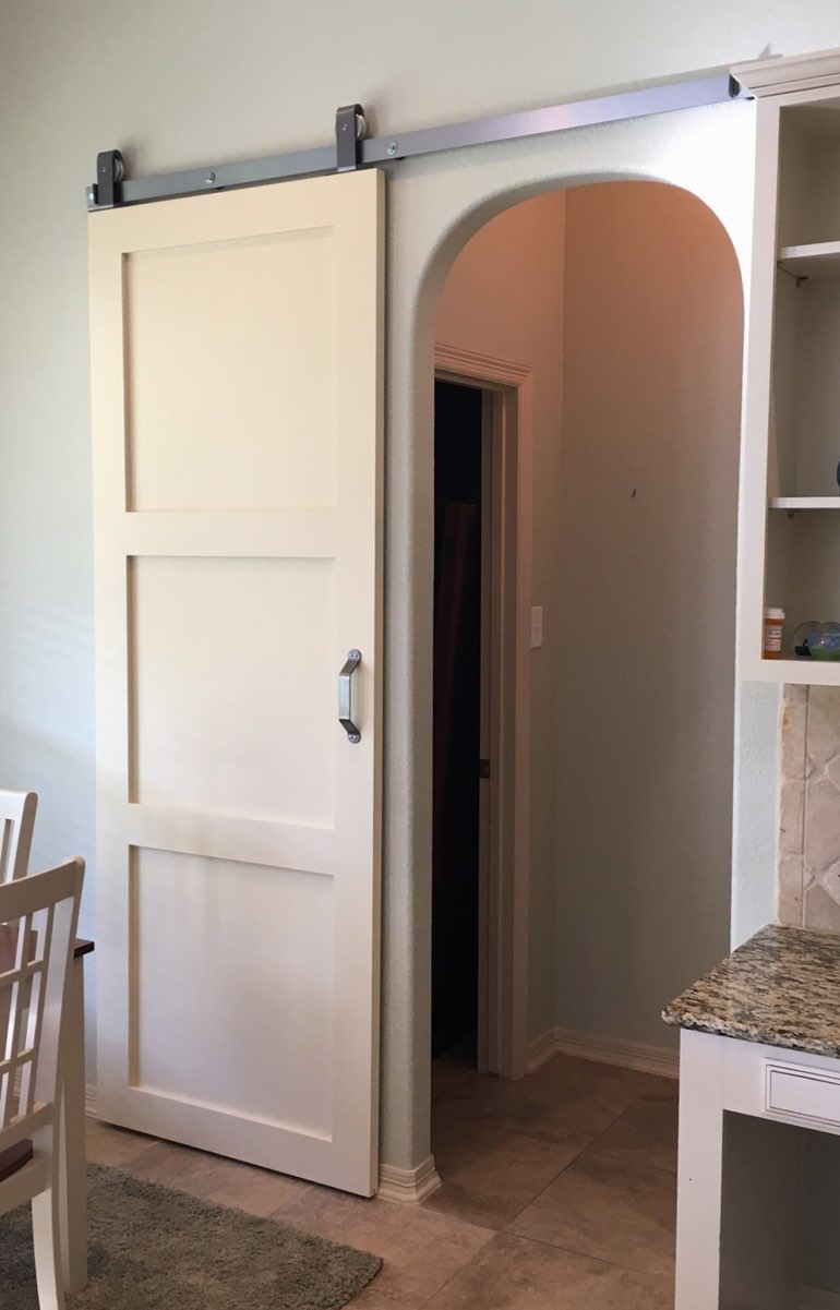 Shaker style barn door in Fort Myers kitchen.