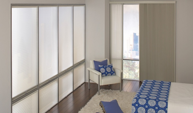 Cellular shades in a streamlined bedroom.