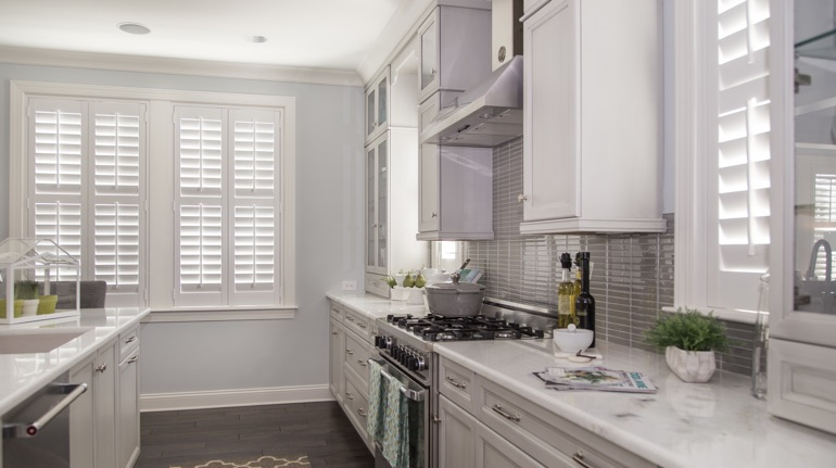 Plantation shutters in Fort Myers kitchen with marble counter.