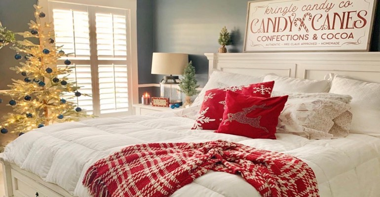 Traditional bedroom with Christmas tree.