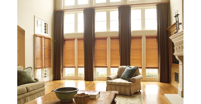 Fort Myers great room with wooden blinds and floor to ceiling drapes.