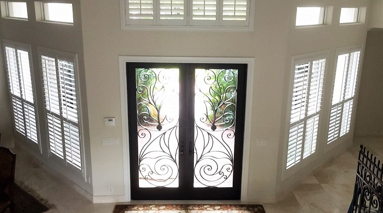 Fort Myers foyer with glass doors and interior shutters