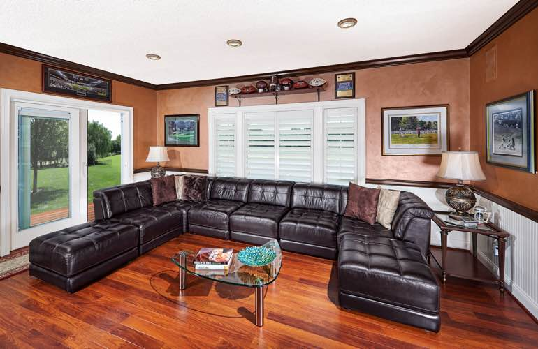 Fort Myers basement with glass doors and plantation shutters.