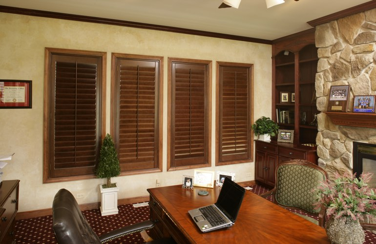 Hardwood plantation shutters in a Fort Myers home office