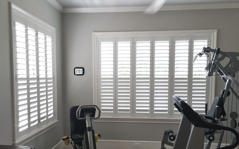 Fort Myers home gym with shuttered windows.