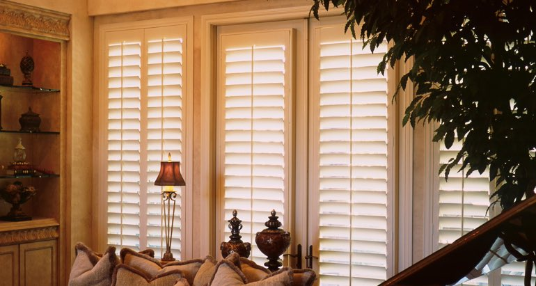 Plantation shutters on windows and door in Fort Myers lounge