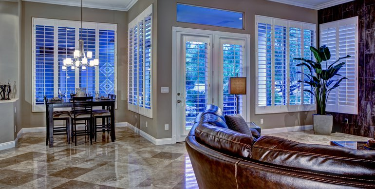 Fort Myers great room with white shutters and modern lighting.