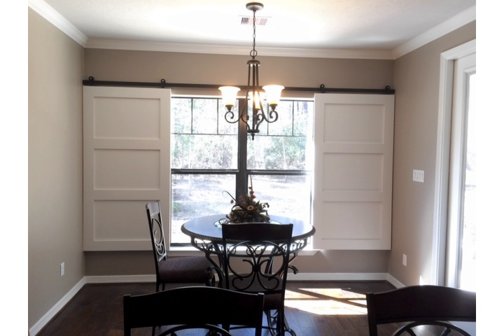 Fort Myers dining room with white barn door shutters.