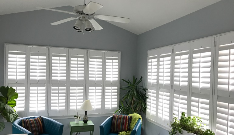 Fort Myers sunroom with fan and shutters
