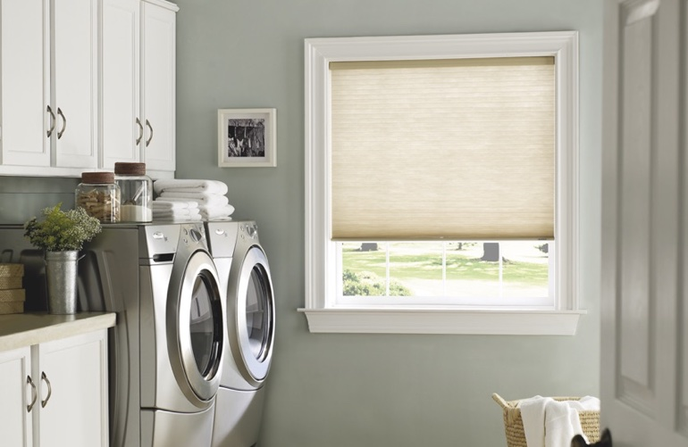 Fort Myers laundry room with tan window shades.