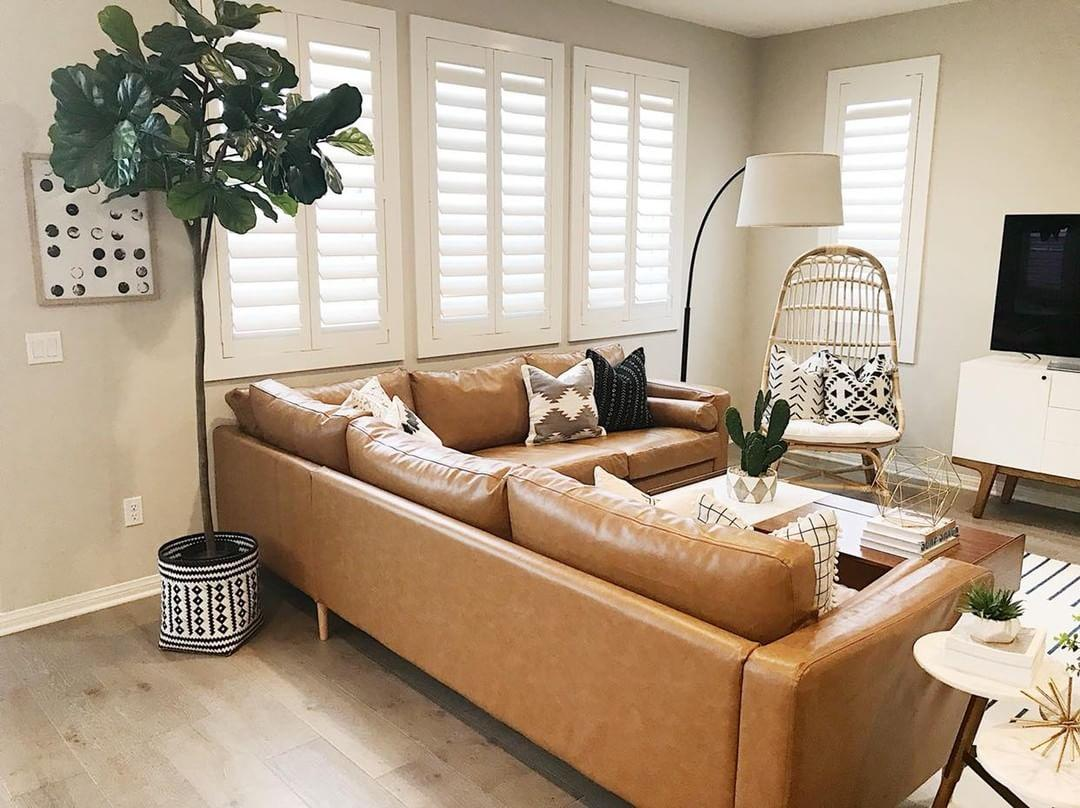 Warm living room with our Polywood shutters in Fort Myers.