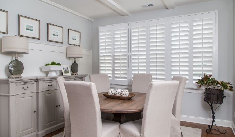 Plantation shutters in a Fort Myers dining room.