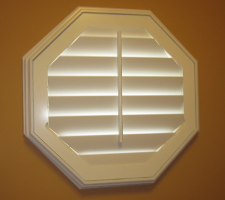 Fort Myers octagon window with white shutter