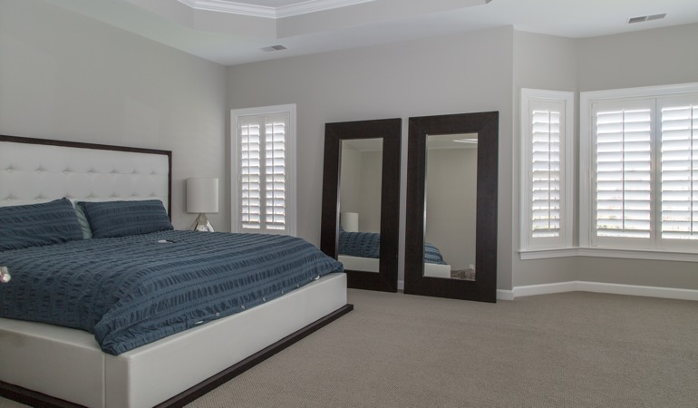 White shutters in a minimalist bedroom in Fort Myers.
