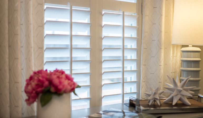 Plantation shutters by flowers in Fort Myers