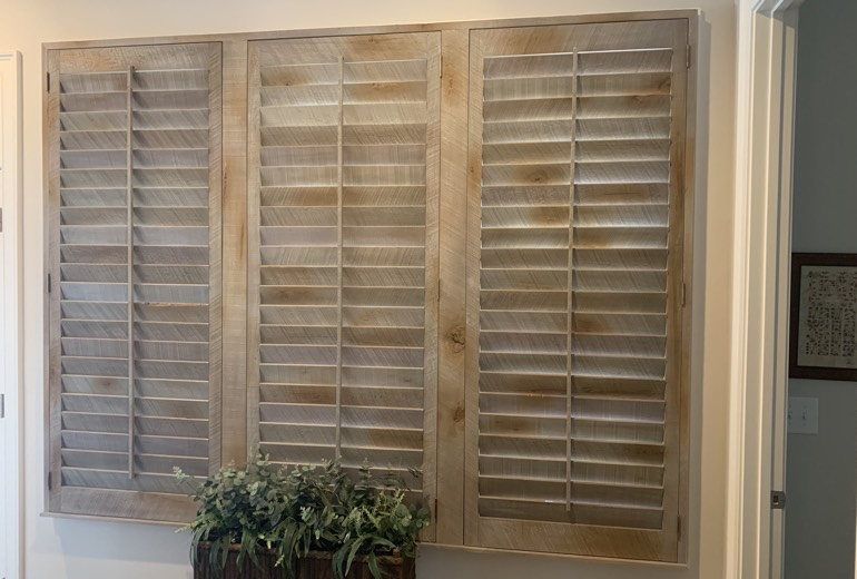 Closed reclaimed wood shutters in Fort Myers