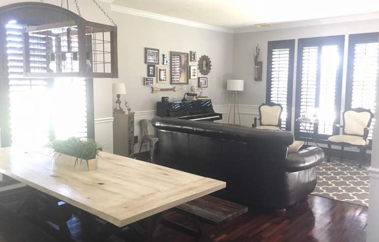 Hardwood shutters in family room windows by Sunburst Shutters Fort Myers.
