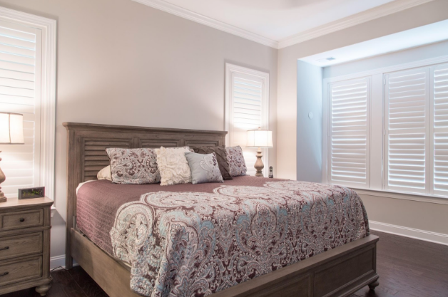 Fort Myers bedroom with light block shutters