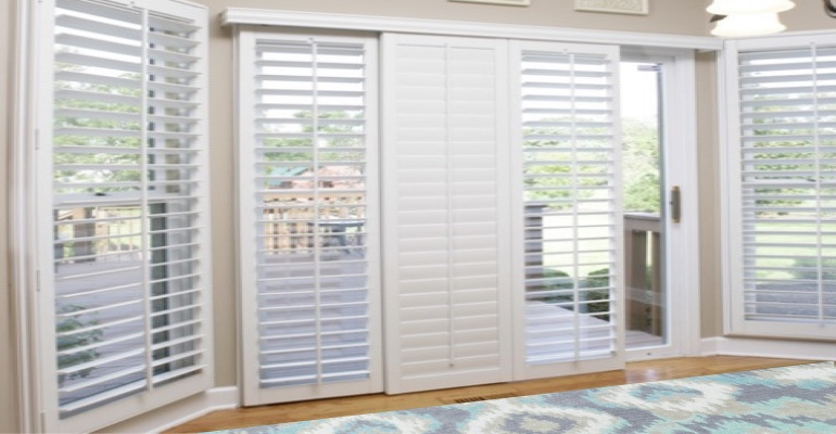 [Polywood|Plantation|Interior ]211] shutters on a sliding glass door in Fort Myers