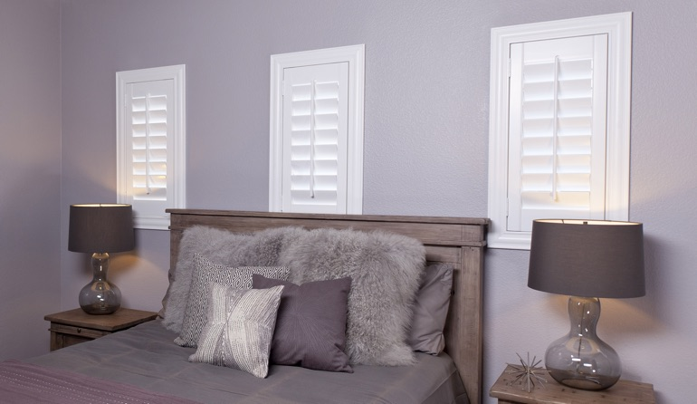 Classic plantation shutters in Fort Myers bedroom windows.