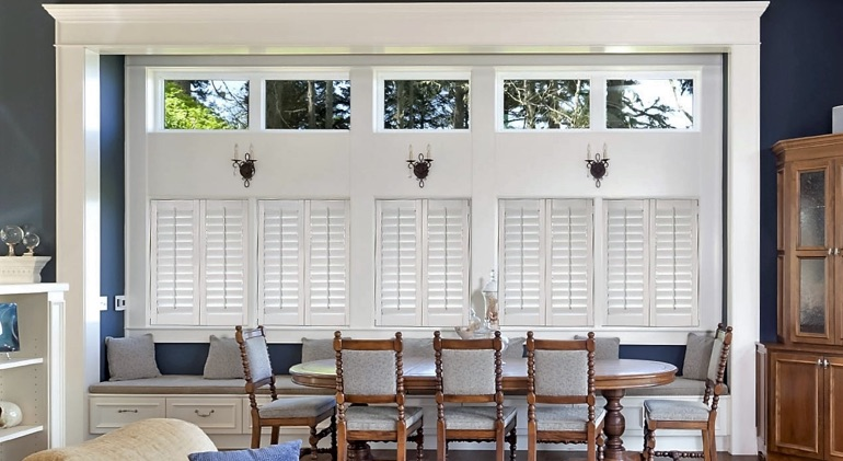 Shut studio plantation shutters in Fort Myers dining room.