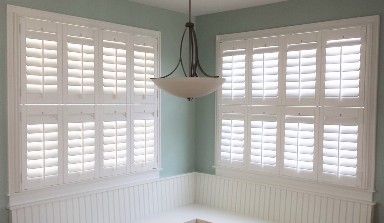 Pastel green wall in Fort Myers kitchen with shutters.