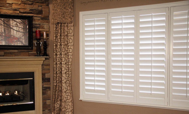 Fort Myers Studio plantation shutters in family room.
