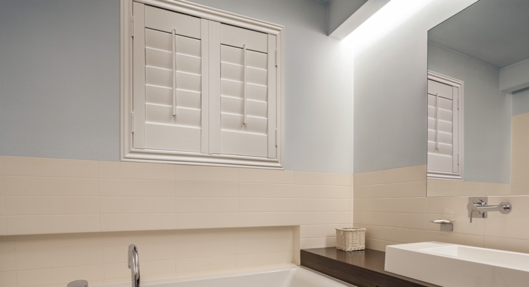 Plantation waterproof shutters in Fort Myers bathroom.
