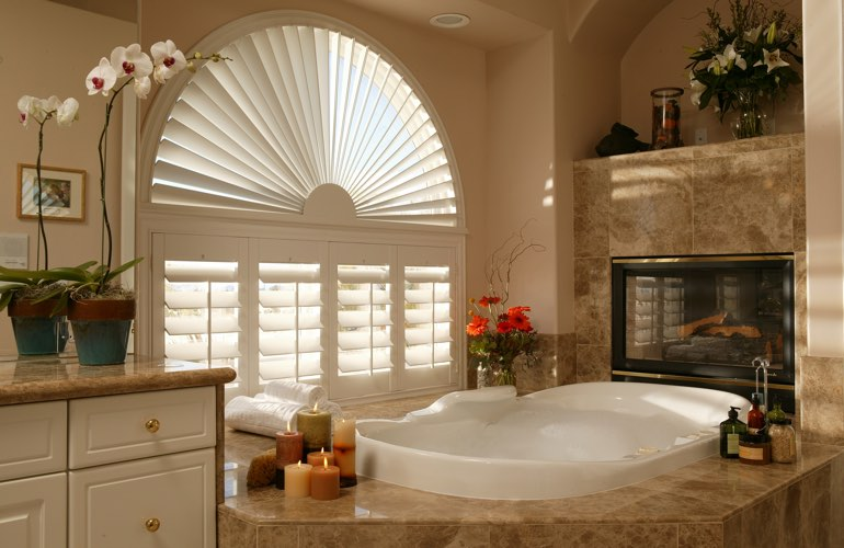 Arched shutters in a Fort Myers bathroom.