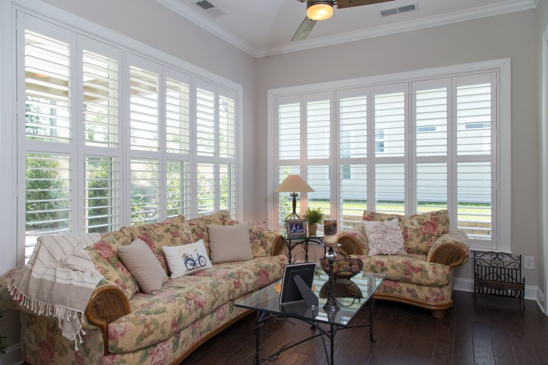 Airy sunroom with interior shutters in Fort Myers.