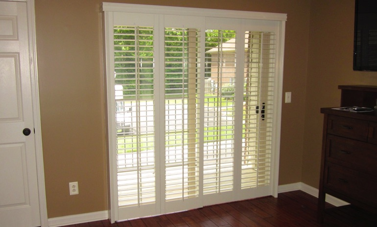 Fort Myers sliding door bifold shutters in den