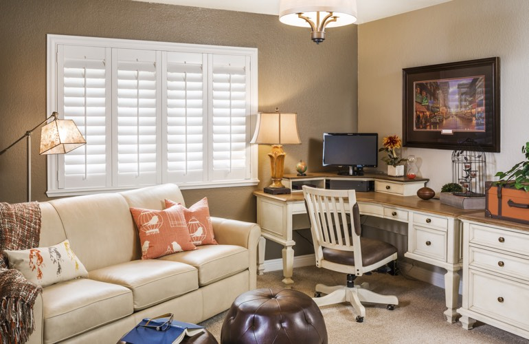 Fort Myers home office with white window shutters.