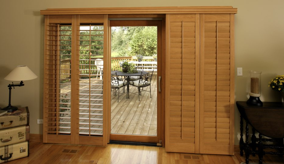 Wood bypass patio door shutters in Fort Myers living room