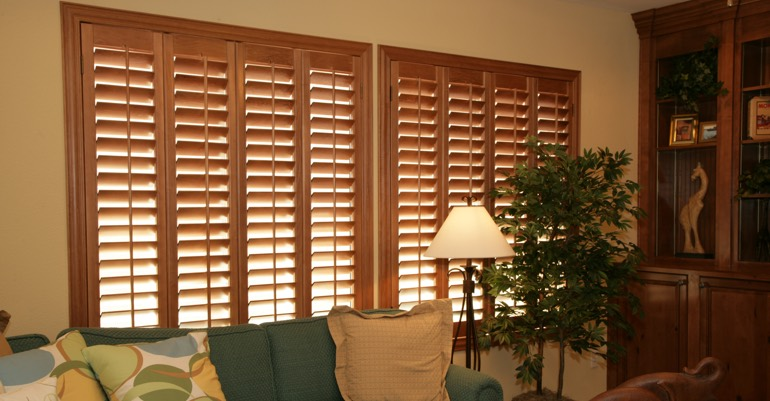 Wood shutters in Fort Myers living room.