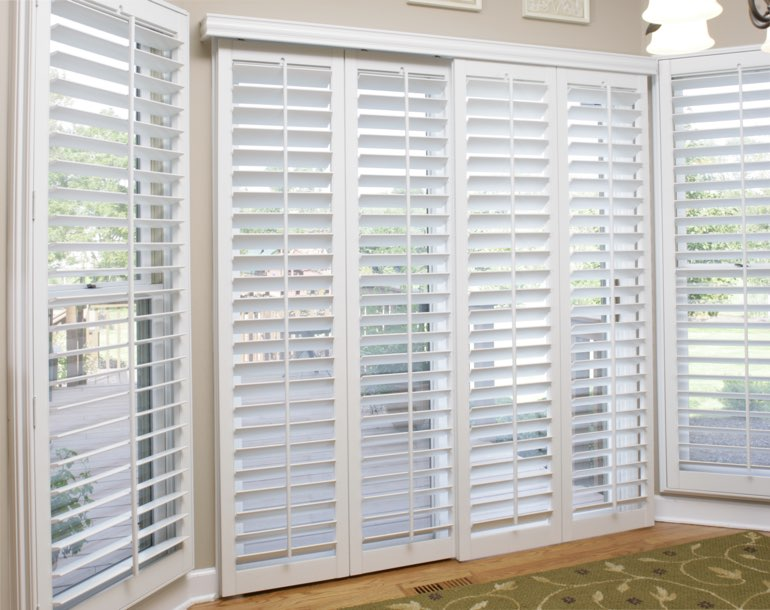 Sliding glass door with white shutters Fort Myers