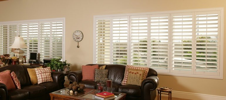 Wide window with interior shutters in Fort Myers living room